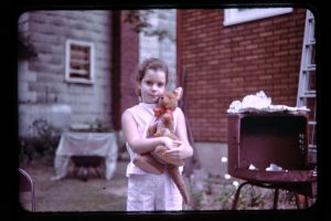 young girl with stuffed animal