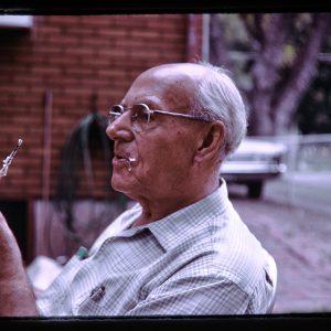older man eating marshmallow