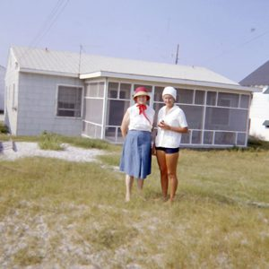 LADIES AT A BEACH COTTAGE