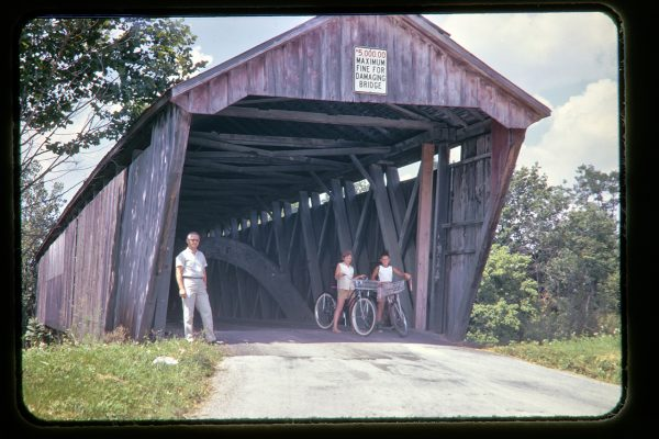 covered bridge with bicyclists