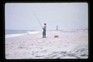 fisherman on sandy beach