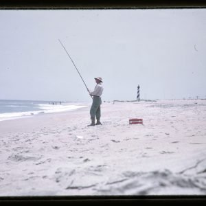 fisherman on sandy beach