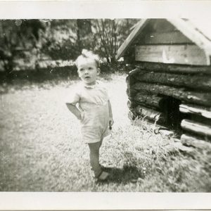 little boy by a dog house 1940s