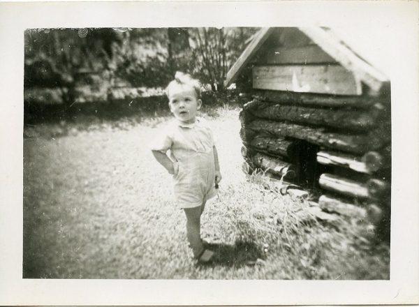 little boy by a dog house 1940s