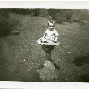 Little boy sitting in a bird bath 1940s