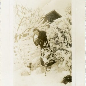 girl hiding with snowball 1940