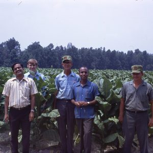 Men visiting a field on a Farm - Walstonburg 7-16-71