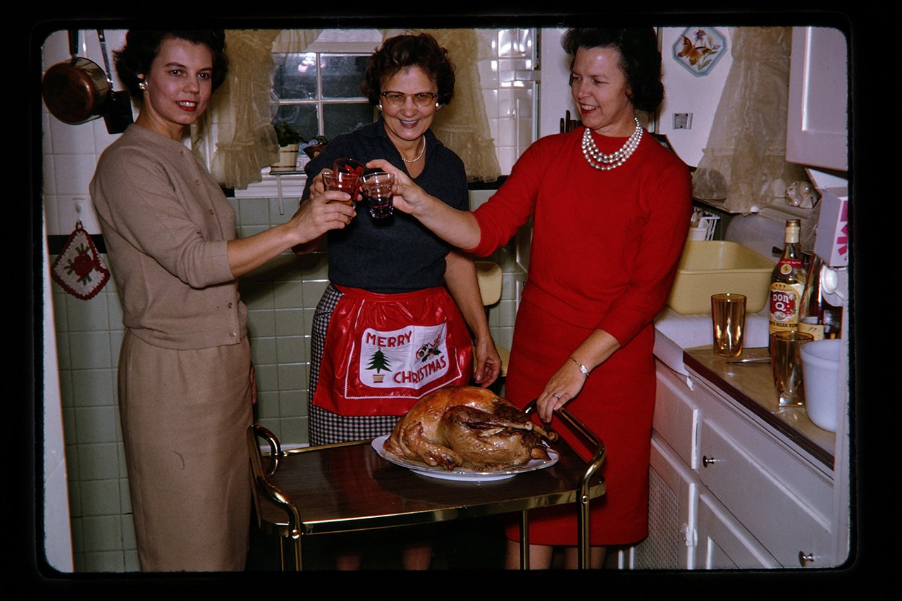women toasting christmas meal