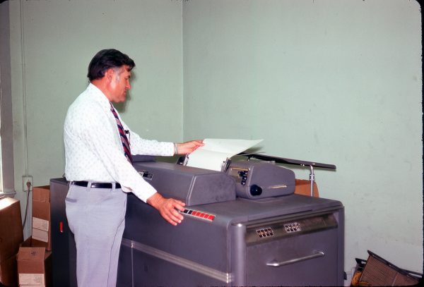 4-25-75 Raymond Alford using the IBM 407 - Office of NC Department of Agriculture