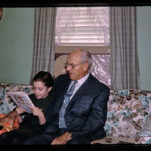 girl reading with grandpa